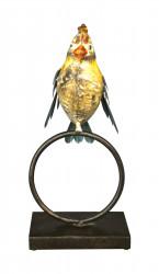 Oiseau en fer forgé sur un anneau
