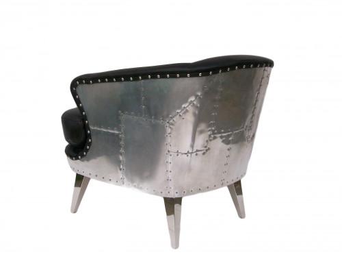Le fauteuil solin en cuir noir et en aluminium