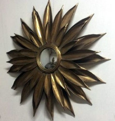Miroir oeil de sorcière en forme de soleil en métal doré de style industriel